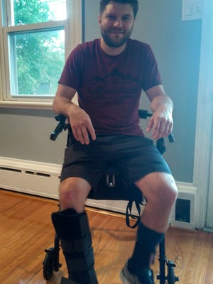 Nate Dohner, pictured in his South Annville Township home on June 6, 2018, suffered injuries to his legs and face after being hit by a pickup truck while bicycling on May 23.