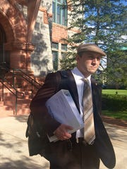 Michael Kelsey walks out of St. Lawrence County Courthouse.