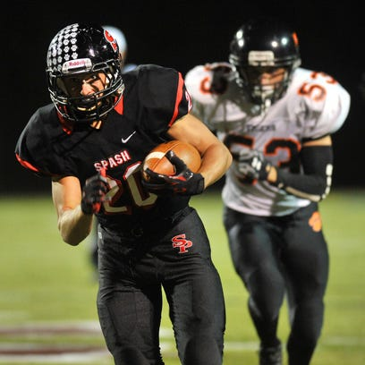 SPASH's Gus Turner-Zick (20) and his teammates take