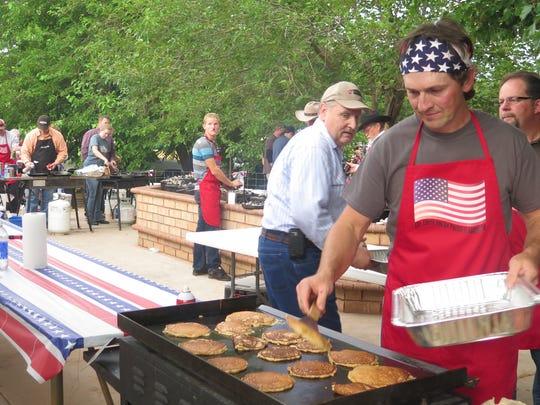 Bygs Dutson cooks pancakes during Colorado City's Fourth
