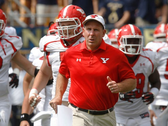 Youngstown State head coach Bo Pelini leads his team