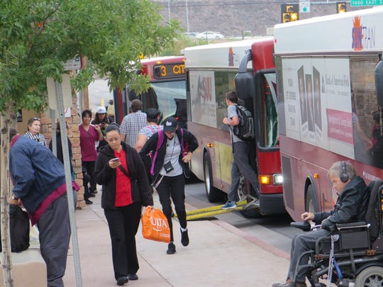 Residents get on and off buses at a SunTran transit station in St. George on Thursday, Oct. 27, 2016.