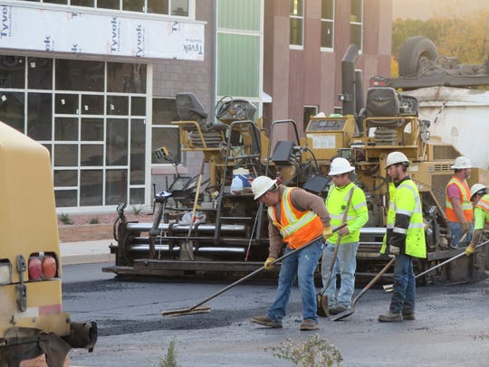 Construction crews complete pavement work in front