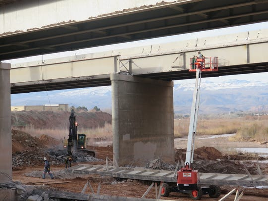 Crews work on a bridge widening project where Interstate 15 crosses the Virgin River in St. George on Friday, Feb. 3, 2016.