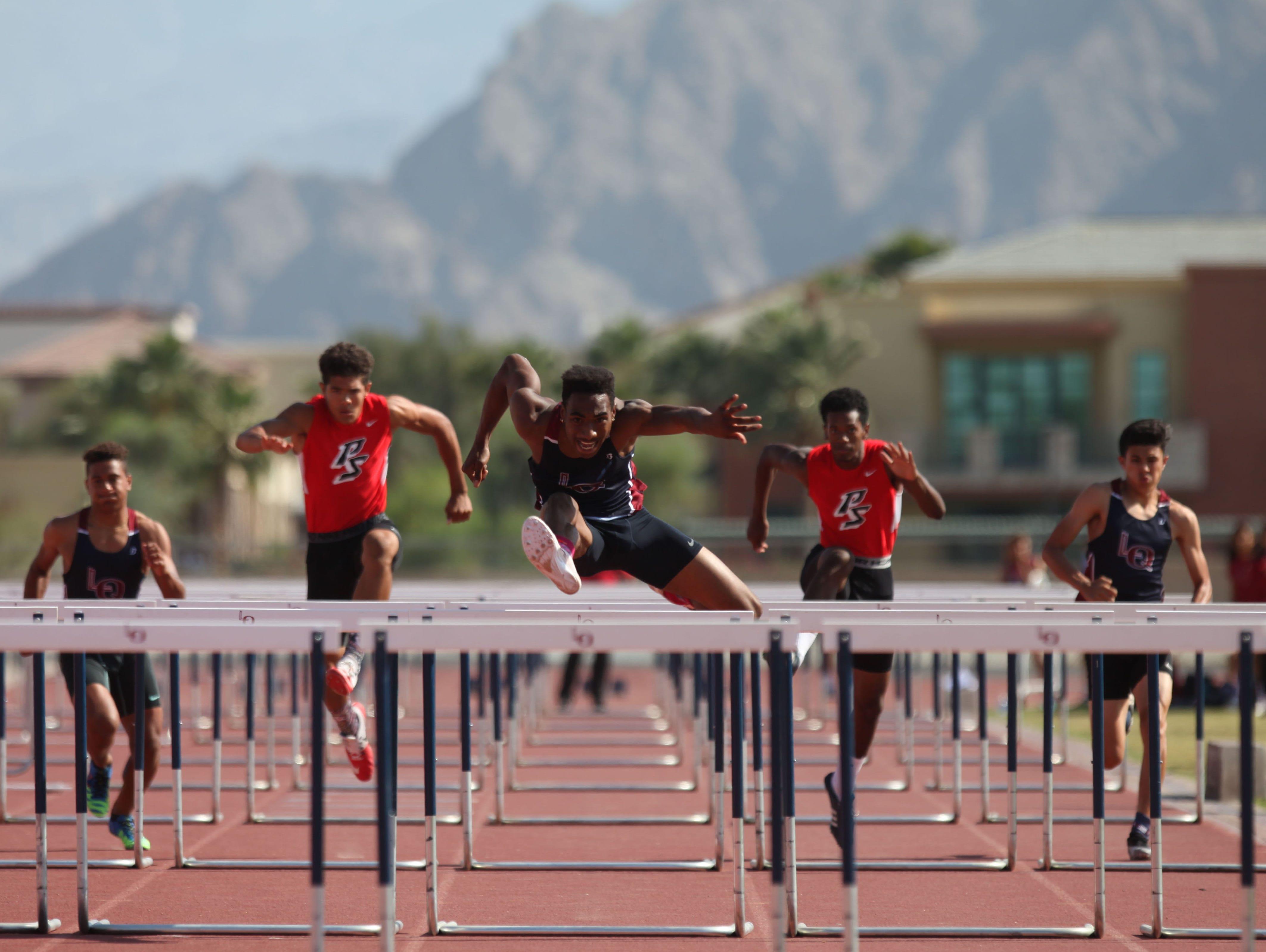 La Quinta High School's Koty Burton easily wins the 100-meter hurdles at La Quinta during his school's meet versus Palm Springs High School.