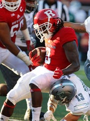 Sep 9, 2017; Piscataway, NJ, USA; Rutgers Scarlet Knights running back Josh Hicks (8) is stopped by Eastern Michigan Eagles defensive back Justin Moody (13) during second half at High Point Solutions Stadium. Mandatory Credit: Noah K. Murray-USA TODAY Sports