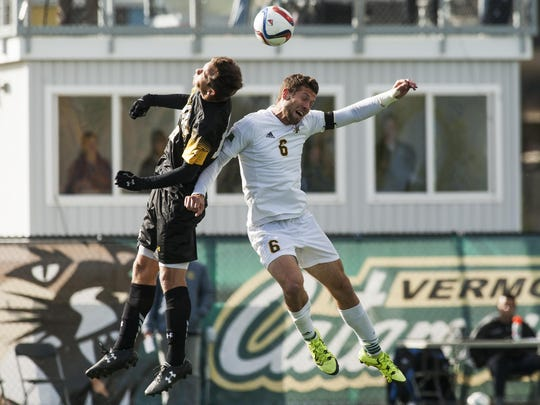 Vermont's Skyler Davis (6) battles for the header with UMBC's Gregg Hauck (13) during the men's soccer game between the UMBC Retrievers and the Vermont Catamounts at Virtue Field on Wednesday afternoon October 14, 2015 in Burlington.
