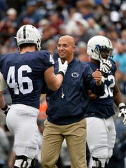 Penn State head football coach James Franklin greets defensive end Colin Castagna before Penn State's Blue-White Game Saturday, April 22, 2017, at Beaver Stadium. The Nittany Lions, now the defending Big 10 champions and fresh off a Rose Bowl appearance, kicked off their annual spring football scrimmage at 3 p.m.