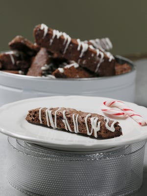 My holiday spin on this recipe was adding pieces of crushed candy cane and chocolate chips to the dough, and then drizzling each biscotti with melted white chocolate, creating a peppermint bark taste.