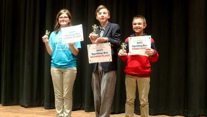 Port Clinton Middle School students Alyssa Libben, Ben Lucas and Elliot Auxter placed first through third, respectively, at Wednesday's spelling bee. They will represent PCMS at the county level competition.