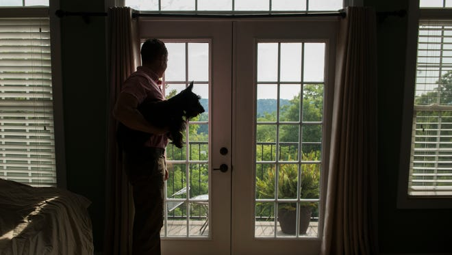 A Clarksville resident looks out the window of his home, which he was preparing to rent out on Airbnb for the 2017 eclipse.