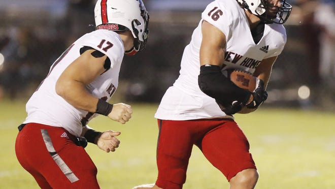 New Home's Kash Starkey (16) carries the ball in the first half of the Leopards' 46-15 loss Friday night at Ralls.