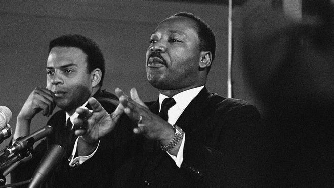 In this Feb. 7, 1968, file photo, Dr. Martin Luther King Jr., center, speaks to an audience and promises a massive demonstration in the spring in Washington.