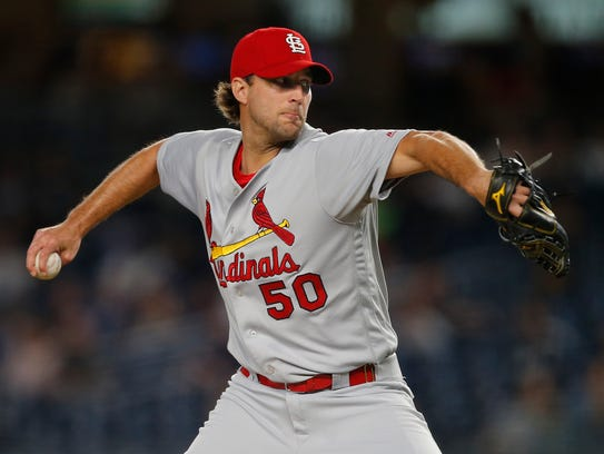 St. Louis Cardinals pitcher Adam Wainwright (50) delivers