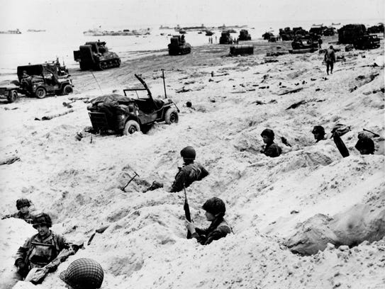 Men and equipment line an invasion beach June 6, 1944.