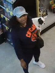 The female suspect holding a puppy.