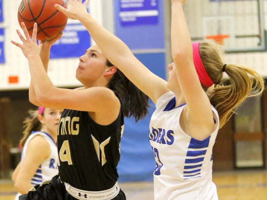 Corning's Danielle Catanese drives to the basket while defended by Jenna Richmond of Horseheads during Tuesday's STAC game at the Horseheads Middle School.