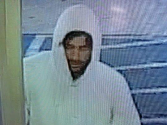 Surveillance footage of Blake Walker robbing the Shell