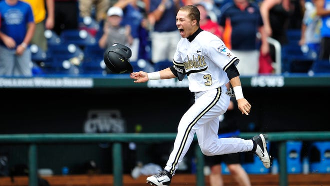 Vanderbilt's Jeren Kendall celebrates his two-run walk-off home run against Cal State Fullerton in the College World Series on June 15, 2015.