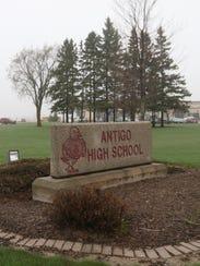 A school bus rolls into Antigo High School through