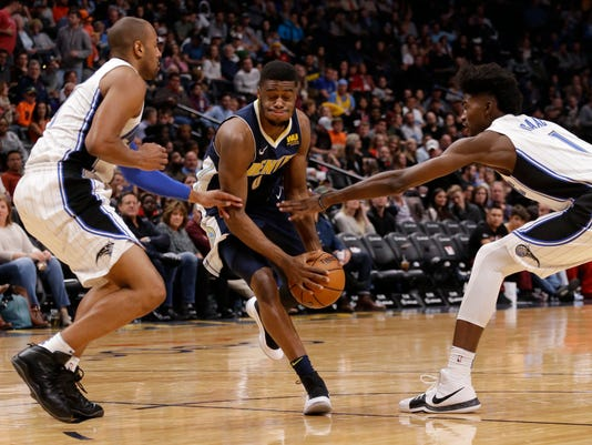 Denver Nuggets guard Emmanuel Mudiay (0) is pressured by Orlando Magic guard Arron Afflalo (4) and Jonathan Isaac (1) during the third quarter of an NBA basketball game Saturday, Nov. 11, 2017, in Denver. (Photo by Jack Dempsey)
