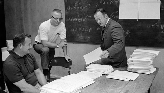 Bo Schembechler is pictured during a meeting with his assistants in 1969.