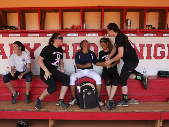 Selena Lugo, Madyson White, Sajarie Jones, McKenzie Corbitt and Summer Ackerson share candy during a break from softball practice at North Fort Myers High School Wednesday.