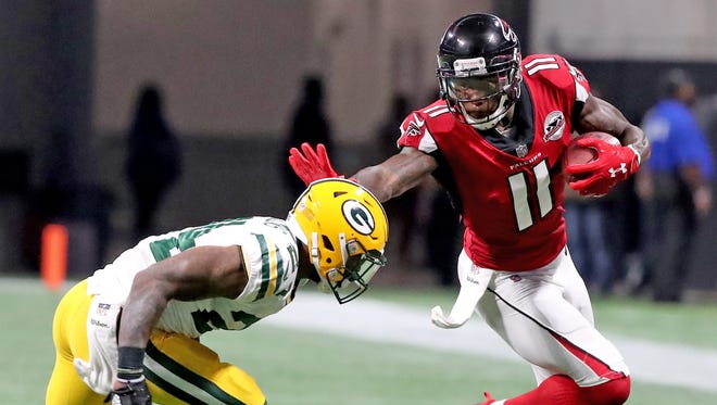 Packers cornerback Quinten Rollins gives up a catch to wide receiver Julio Jones (11) during a September 2017 game against the Falcons at Mercedes-Benz Stadium in Atlanta.