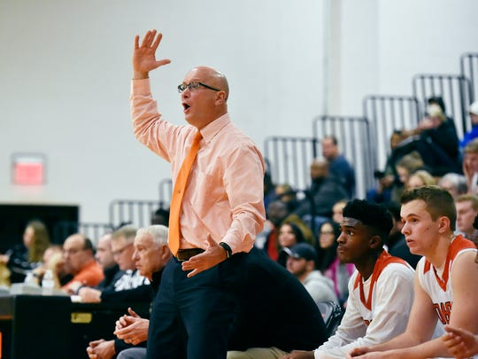 Northeastern head coach Jon Eyster reacts during the second half of a boys' basketball game Friday, Dec. 28, 2017, in the first round of the Bobcat Tip-Off Classic at Northeastern. Northeastern defeated Delone Catholic 80-40.