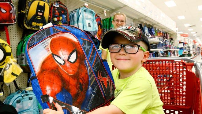 Colton Wilks of Rome, Pennsylvania shows off a Spiderman backpack at Target in Vestal on Tuesday August 15, 2017.  Wilks is preparing to start kindergarten in September.