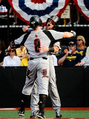 Louisville's Danny Rosenbaum celebrates with Zach Lucas after hitting a two-run dinger. May 30, 2015