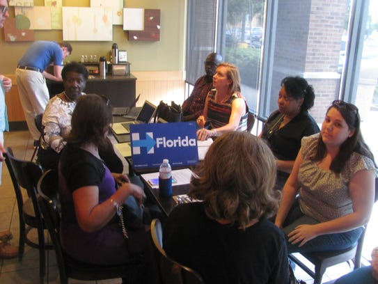 Hillary Clinton volunteers gather at a Starbucks in