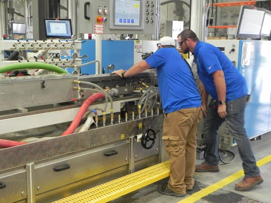 Workers at the newly opened Deceuninck plant in Fernley