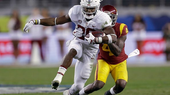 Stanford running back Bryce Love tries to break the
