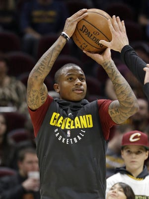 The Cavaliers' Isaiah Thomas warms up against the Nets Nov. 22, 2017 in Cleveland. Thomas will make his debut for Cleveland on Tuesday night against Portland after being sidelined with a hip injury. The All-Star has been out since last year's Eastern Conference finals with Boston. But after months of grueling rehab, Thomas will finally take the floor with Cleveland, which acquired him during the offseason in the blockbuster trade that sent Kyrie Irving to the Celtics. Thomas has building up his strength in recent weeks in scrimmages and has finally been cleared by Cleveland's medical and training staffs to play in a game.