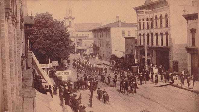 An image from a parade through downtown Ionia in the early 1900s. General Kidd and the Light Guard are pictured marching. The old Methodist church, which burned down in October 1930, is pictured in the background.