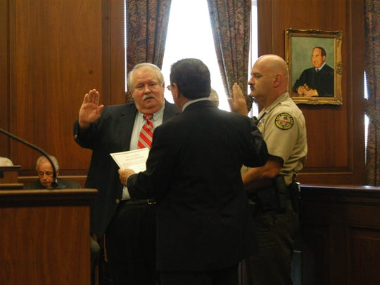 Sumner County Judge James Hunter administered the oath of office in 2014 to General Sessions Court, Juvenile Division Judge Barry Brown, left.