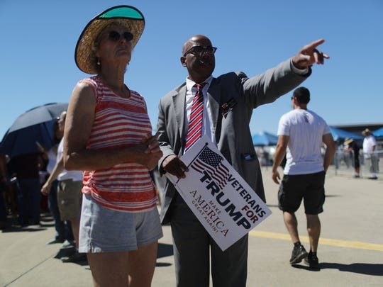 """Gregory Cheadle, right, was singled out by Donald Trump during his visit to Redding in June 2016 as """"my African-American over there."""""""