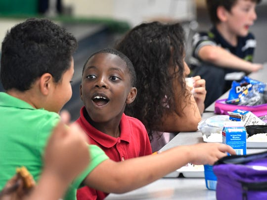 Cortez Murphy eats lunch at Amqui Elementary School with friends on Tuesday May 16, 2017, in Nashville, Tenn.