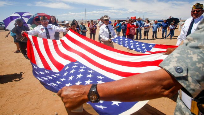 VFW 9517 members hold a re-flagging ceremony on Monday during a Memorial Day event at the Shiprock Veterans Memorial Cemetery.