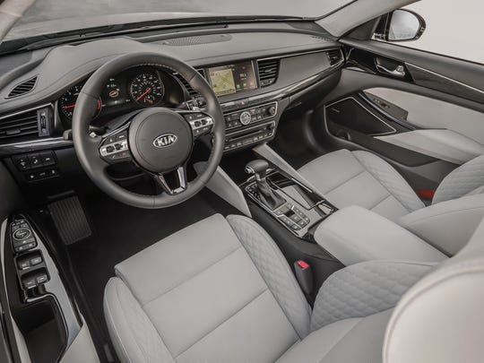 The 2017 Kia Cadenza features a cleanly styled two-level dash with a touchscreen at top and logically arranged knobs on the lower leve.