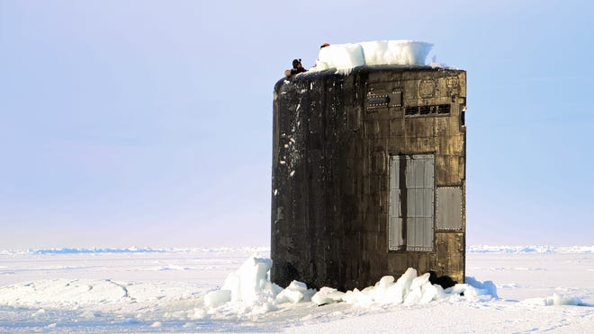 The attack submarine Hampton surfaces in 2014 at on an ice sheet during Ice Exercise. The Navy is studying ways to boost operations in the Arctic as thinning ice opens more waters.