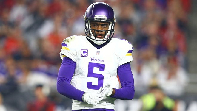 Minnesota Vikings quarterback Teddy Bridgewater (5) reacts in the second half against the Arizona Cardinals at University of Phoenix Stadium.