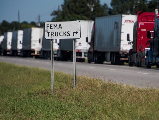 FEMA trucks line up to enter Maxwell Air Force Base