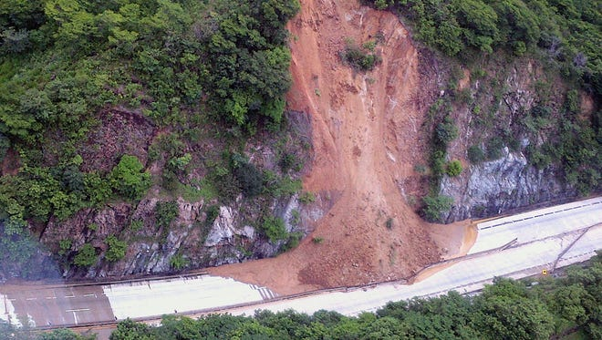 This handout photo taken and released on Sept. 18, 2013, by Mexico's Interior Ministry press office shows an aerial view of a landslide along a highway going to Acapulco, in the Mexican state of Guerrero.