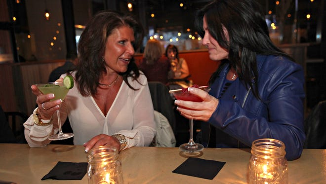 """From left, Nancy Grasso of Bedford and Laura Troccoli of Bedford Corners, enjoy a """"Girls Night Out"""" at the Village Social in Mount Kisco March 20, 2014."""