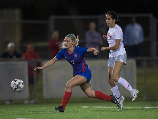Gregory-Portland Ryley Lapka drives the ball up the field during the District 30-5A championship game against Veterans Memorial at Cabaniss Soccer Field on Friday, Match 23, 2018.