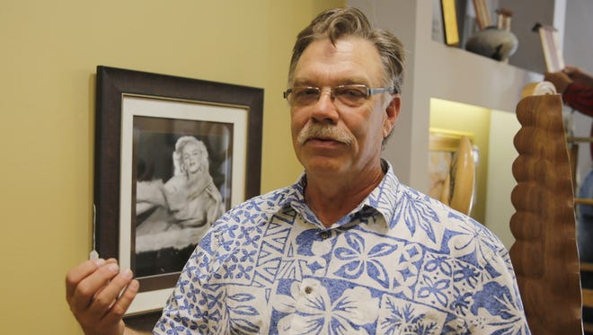 Kirtland artist Rick Conrad discusses his work at the Hubble & Barr Galleries, where his drawings will be featured during the summer art walk.