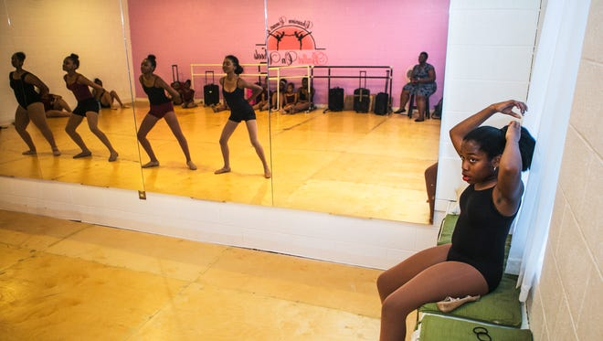 """May 25, 2017 - Tamia Elliott, 12, looks at her fellow dancers as they practice a scene during rehearsal for the dance performance of """"Annie"""" at the Ballet On Wheels Dance School & Company in Cooper Young on Thursday. Elliott is portraying the lead character in the adaption of the movie classic. Performances will be held on Saturday, June 3, at 7 p.m. and Sunday, June 4, at 2:30 p.m. at the Halloran Centre for Performing Arts and Education at 225 S. Main St. Tickets are available at www.ticketmaster.com."""