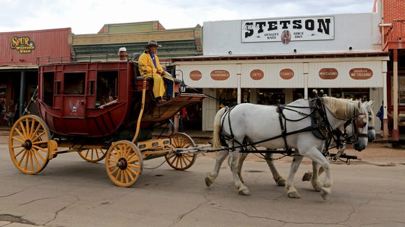 A stage coach travels down Allen Street in historic Tombstone, Ariz.